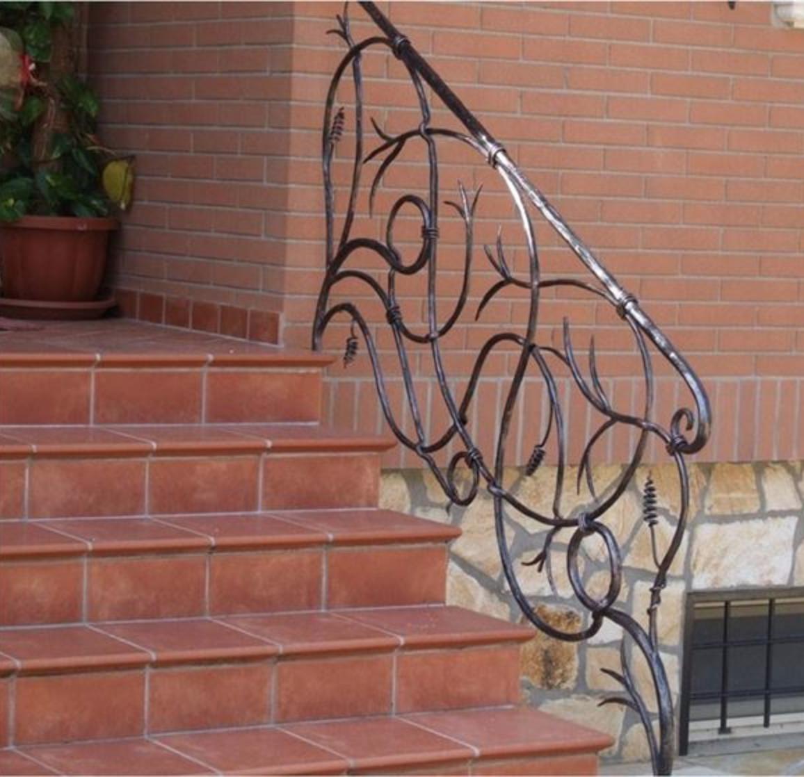 Rampe escalier en fer forge ferronnerie d art ferronnerie d art for Prix porte en fer forge